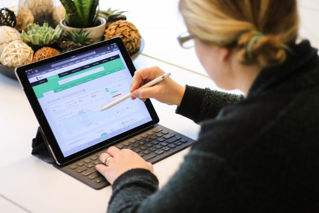 A woman reviews digital marketing campaign analytics to determine whether her company's efforts are achieving results.