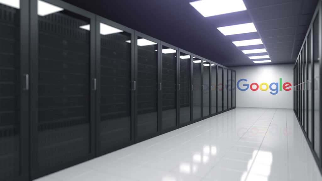 Black cabinets house Google's servers responsible for their search algorithms in a clean, sterile-looking environment.