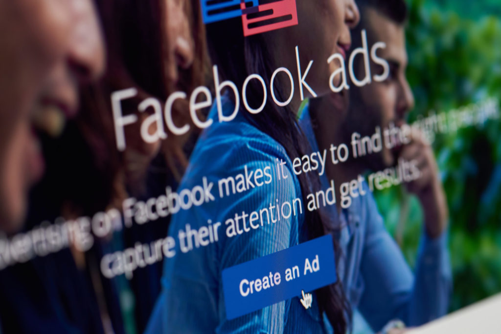 """Facebook's landing page with the cursor over the """"create an ad"""" button."""