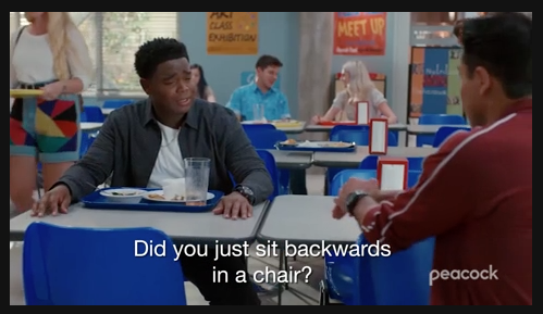 """Characters from a scene in Peacock's new """"Saved By the Bell"""" series sit at a high school lunch table."""